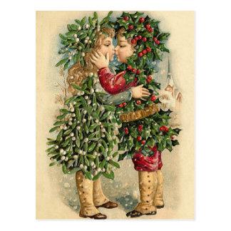 Alte Mode-Stechpalmen-Kinder, die Weihnachten Postkarte