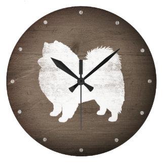 Amerikanische EskimohundeSilhouette rustikal Große Wanduhr
