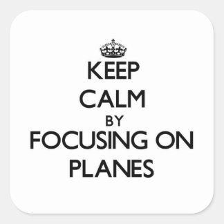 Behalten Sie Ruhe, indem Sie auf Flugzeuge sich Quadratsticker