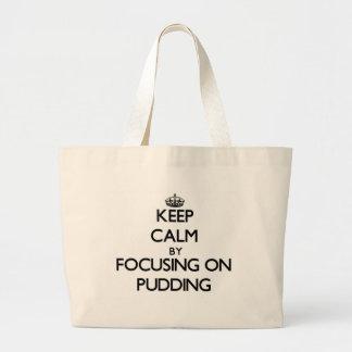 Behalten Sie Ruhe, indem Sie auf Pudding sich Taschen