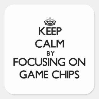 Behalten Sie Ruhe, indem Sie auf Spiel-Chips sich Quadratischer Aufkleber