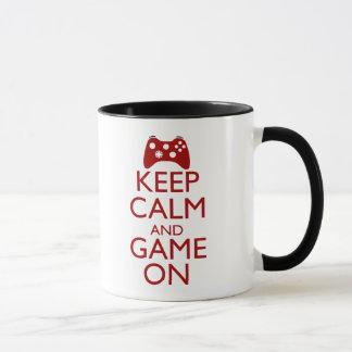 Behalten Sie Ruhe und Spiel an Tasse