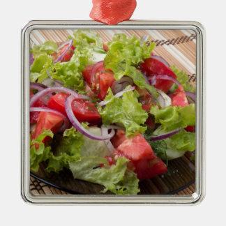 Blickwinkel auf einem Fragment des vegetarischen Quadratisches Silberfarbenes Ornament