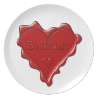 Bretagne. Rotes Herzwachs-Siegel mit Party Teller