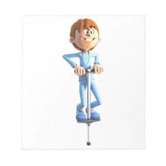 Cartoon-Junge auf einem Pogo Stock Notizblock