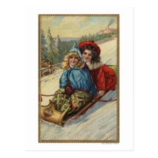 ChristmasTwo kleine Mädchen Sledding Postkarte