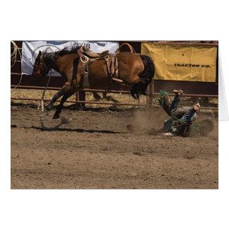 Cowboy erhält einen Tritt aus Bronc-Reiten heraus Karte