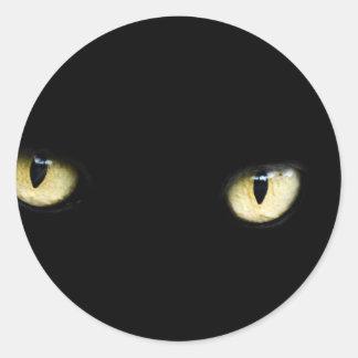Die schwarzen Katzenaugen Runder Aufkleber