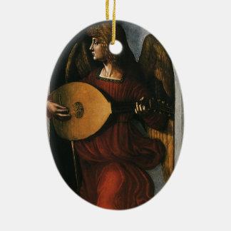 Ein Engel im Rot mit einem Dichtungskitt durch Keramik Ornament