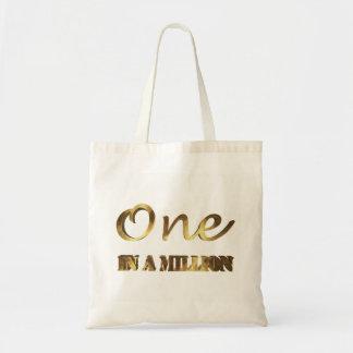 Ein in Million eleganter Goldbrown-Typografie Tragetasche