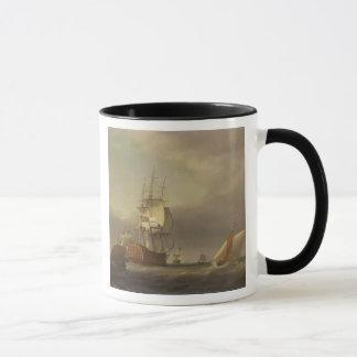 Ein Meerblick mit Mann-von-Krieg und kleinem Tasse