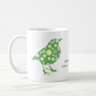 Eleganter stilvoller grüner Vogel mit Tasse