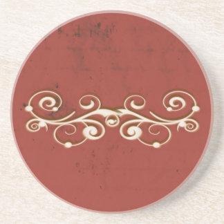 Eleganter Wirbel auf einem Rot Sandstein Untersetzer