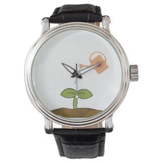 ErdtagesPflanzenbäume stellen eine Unterschied-Uhr Handuhr