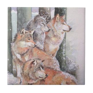 Erster Schnee. Wolfsrudel. Rote Wölfe Fliese