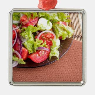 Foodstyle Hintergrund-Nahaufnahmeansicht eines Quadratisches Silberfarbenes Ornament