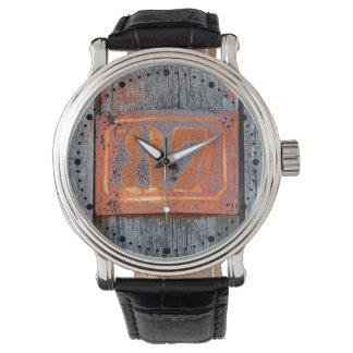 Fotonummernscheibe der alter Grunge-rostige Uhr
