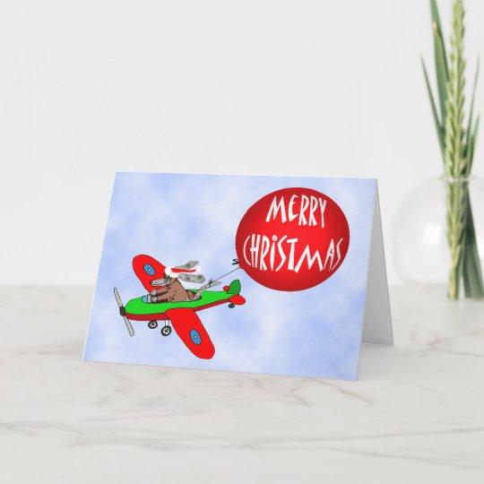 Frohe Weihnachten Flugzeug.Frohe Weihnachten Hundepilot Im Flugzeug Mit Feiertagskarte