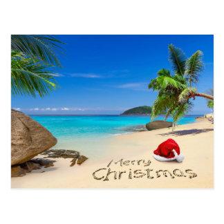 Frohe Weihnachten mit Weihnachtsmannmütze in den Postkarte