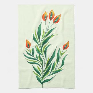 Frühlings-grüne Pflanze mit den orange Knospen Küchentuch