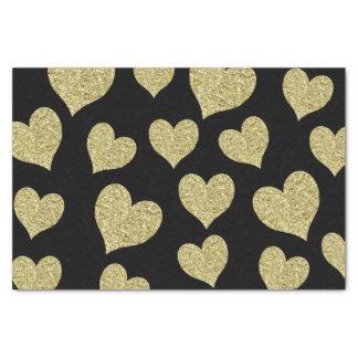 GoldGlitter-Herzen auf Schwarzem Seidenpapier