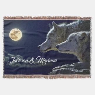 Graue Wölfe unter einem Vollmond Decke