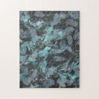 Grüne und weiße Tinte auf schwarzem Hintergrund Puzzle