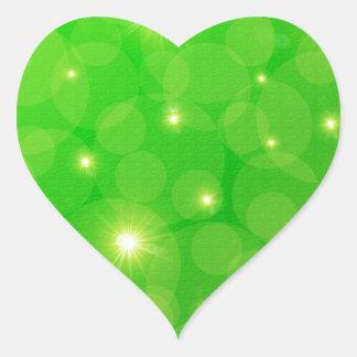 grüner Hintergrund mit gelben Sternen Herz-Aufkleber