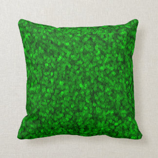 Grünes granuliertes kissen