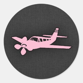 Hellrosa Flugzeug Runder Aufkleber