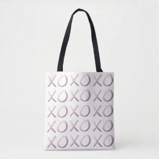 Imitat-Rosen-Goldtypographie umarmt und küsst xoxo