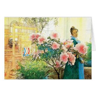 Karin mit rosa Blumen und ihrem Webstuhl Karte