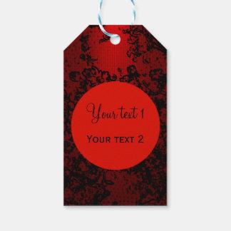 Karminrotes Rot auf schwarzem vibrierendem mit Geschenkanhänger