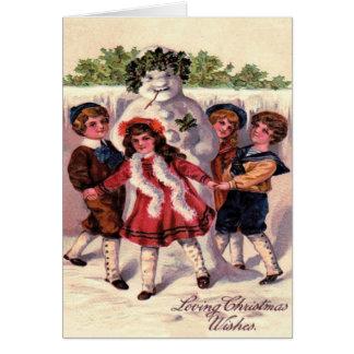 Kinder, die Schneemann-Kranz-Stechpalme tanzen Karte