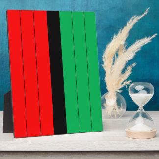 Kwanzaa färbt rotes schwarzes grünes fotoplatte