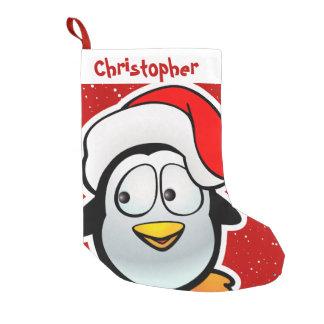 Lustiger Penguin mit roter Weihnachtsmannmütze Kleiner Weihnachtsstrumpf