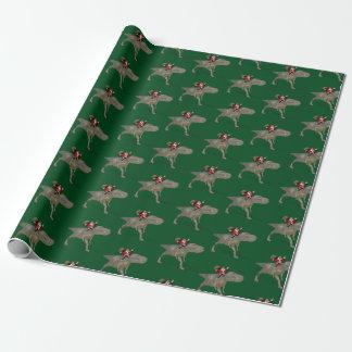 Lustiges Weihnachtsmann-Reiten auf Trex Dino Geschenkpapier