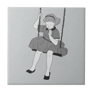 Mädchen auf einem Schwingen Fliese