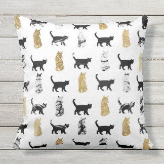 Miezekatze-Katzen im Gold und im Zierkissen