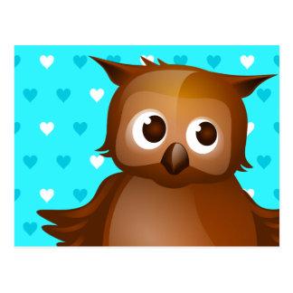 Niedliche Eule auf blauem Herz-Muster-Hintergrund Postkarte