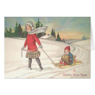 Niedliche Kinder, die Schlitten-Schnee Sledding Karte