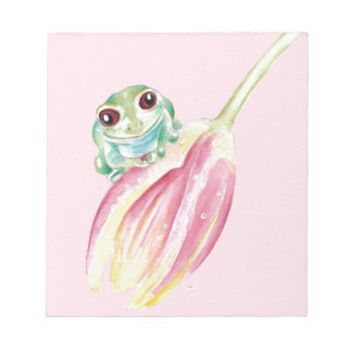 Niedlicher Frosch auf Rosa Notizblock