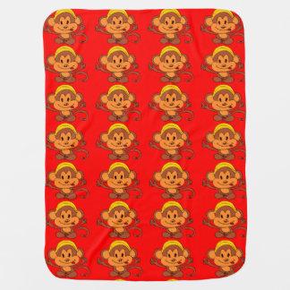 Niedlicher Playful Affe mit Bananen-Rot/Brown Baby-Decken