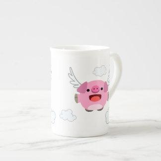 Niedliches Fliegen-Cartoon-Schwein Prozellantasse