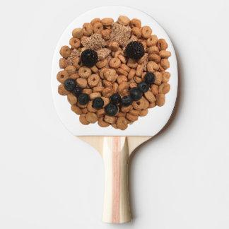 Niedliches lächelndes Frucht-und Getreide-Gesicht Tischtennis Schläger