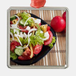 Nützlicher und natürlicher Gemüsesalat der Tomate Silbernes Ornament