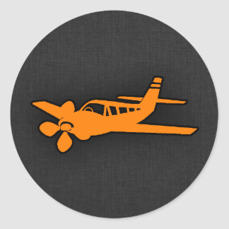 Orange kleines Flugzeug Runder Aufkleber