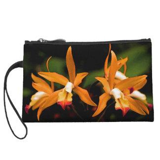 Orange Orchidee blüht Minikupplung Wristlet