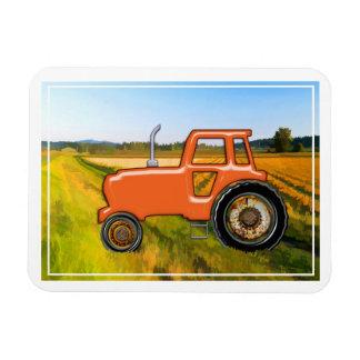 Orange Traktor auf den Bauernhof-Gebieten Rechteckiger Fotomagnet
