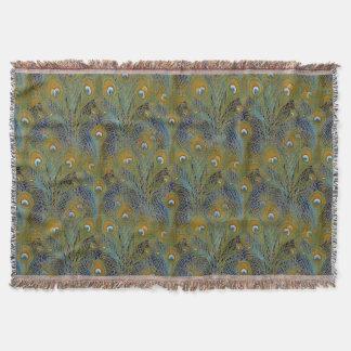 Pfau versieht Wolldecken mit Federn Decke